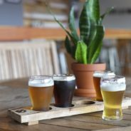 4 glasses of beer on a table